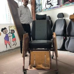 A teacher hero – making home-made desks for refugee children with disabilities